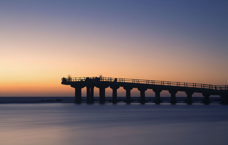 Silhouette of Bridge Architecture Bridge - Man Made Structure Outdoors Sea Silhouette Sunset Travel Destinations Water Fresh On Market 2016