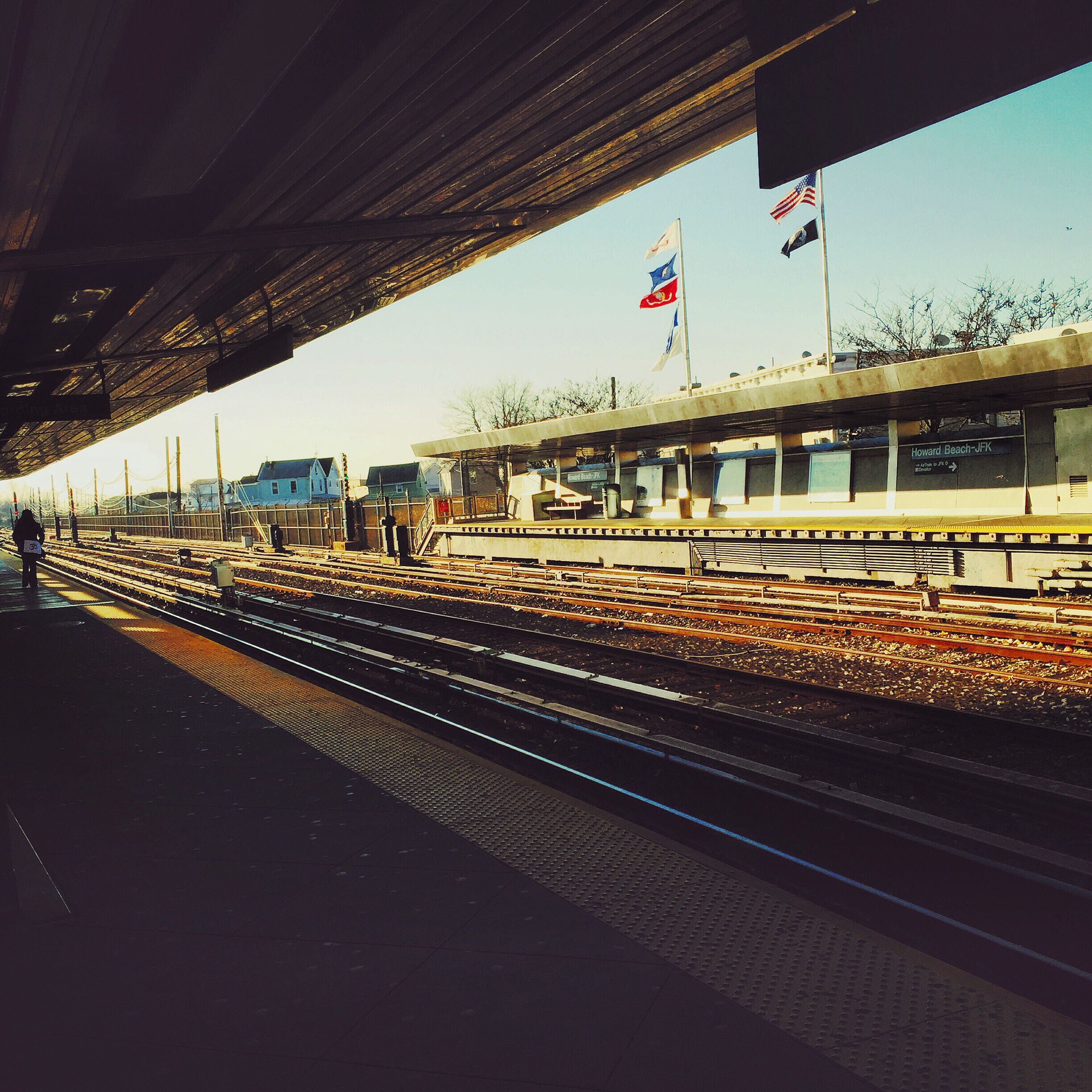 railroad track, transportation, rail transportation, railroad station platform, railroad station, public transportation, architecture, built structure, sky, train - vehicle, travel, railway track, building exterior, the way forward, mode of transport, city, station, passenger train, diminishing perspective, road