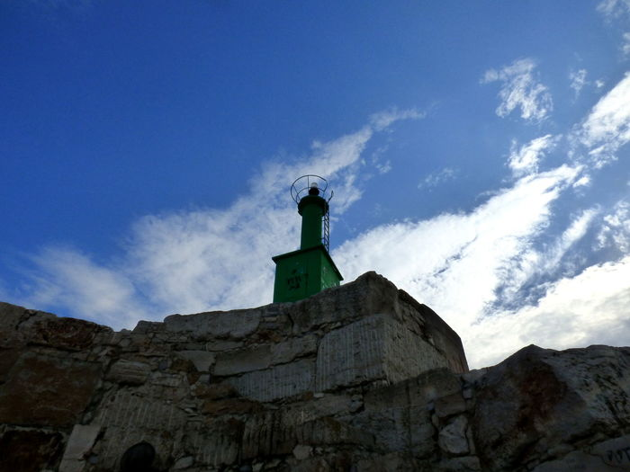 Architecture Blue Bright Beacon In The Port Of Peñiscola Building Exterior Built Structure Cliff Cloud Cloud - Sky Day Façade Fort High Section History Low Angle View No People Outdoors Outline Sky Solitude Stone Weathered