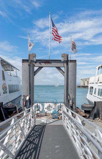 Alcatraz Boat Bridge - Man Made Structure City Cloud - Sky Day Ferryboat Flag Frame Nautical Vessel No People Outdoors Sea Sky Suspension Bridge Transportation Travel Travel Destinations USA Water