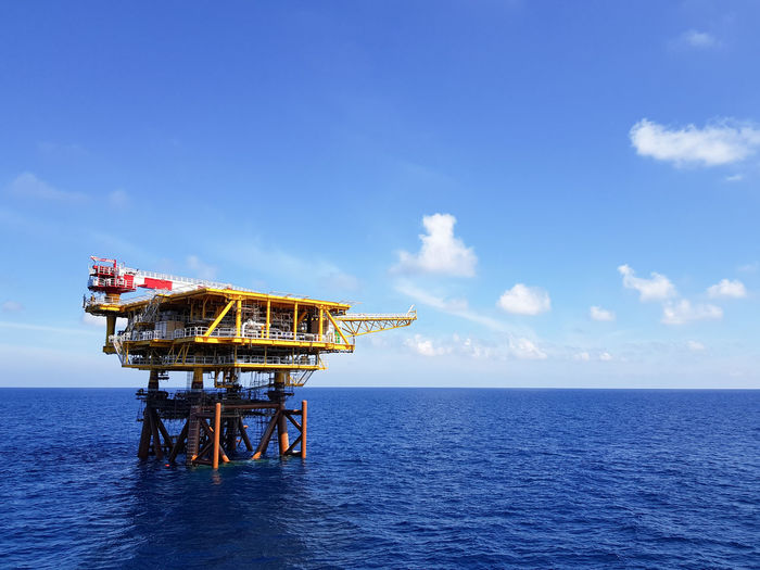 A newly installed oil and gas jacket and topside production unit against blue sky and white clouds as background. Construction Blue Sky Blue Waves Built Structure Day Drilling Rig Energy Industry Engineering Fuel And Power Generation Horizon Over Water Industry Nature No People Offshore Platform Oil And Gas Oil And Gas Industry Oil And Gas Rig Oil Industry Petroleum Petroleum Engineering Sea Sky Technology First Eyeem Photo