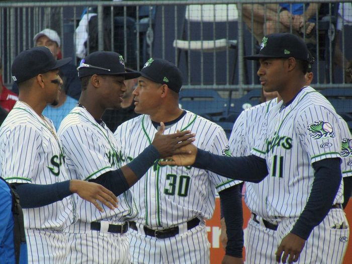 Gwinnett Stripers team introductions Johan Camargo Ronald Acuña Ezequiel Carrera Carlos Franco Handshake Johan Camargo Ronald Acuna Stripers Gwinnett Milb Baseball Sports Group Of People Leisure Activity Real People Architecture Men Lifestyles People Young Men Cap