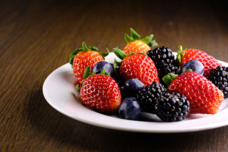 Fresh berry fruits on plate
