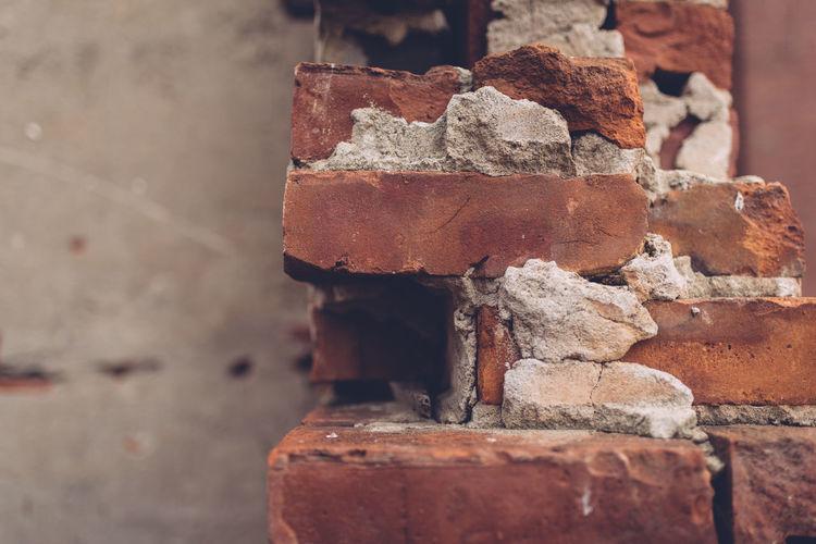 Close-up of damaged brick wall