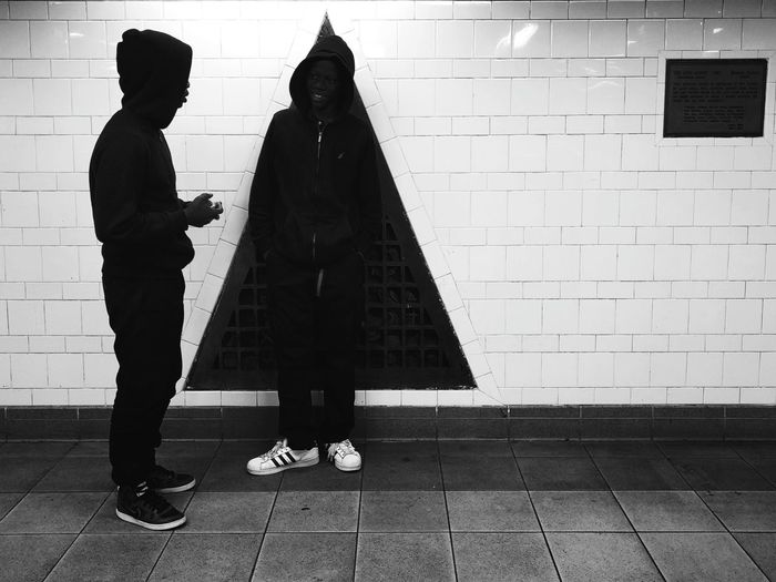 People standing on tiled floor