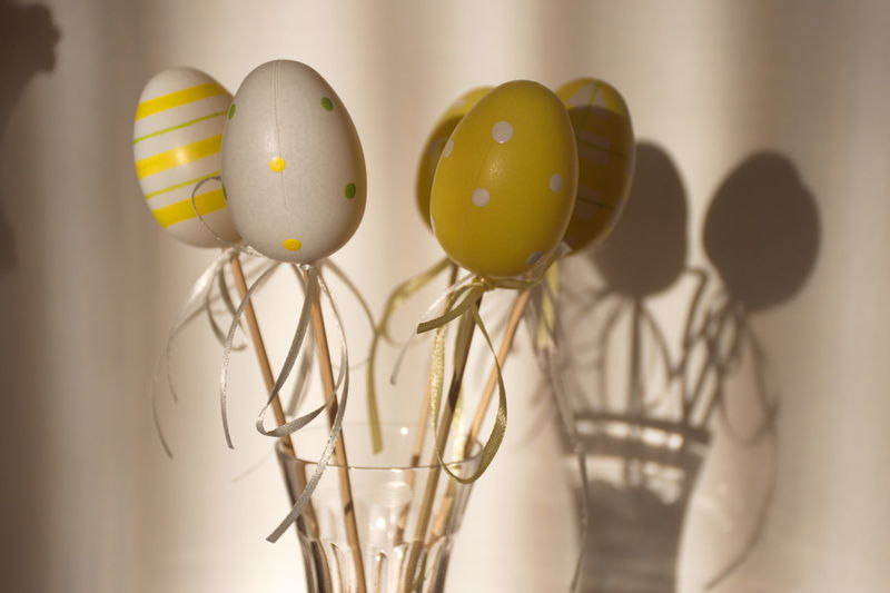 Indoors  Egg No People Still Life Close-up Easter Celebration Food Focus On Foreground Group Of Objects Vulnerability  Fragility Decoration Easter Egg Yellow Selective Focus Shadow Ribbon Bow Easter Decoration Holiday