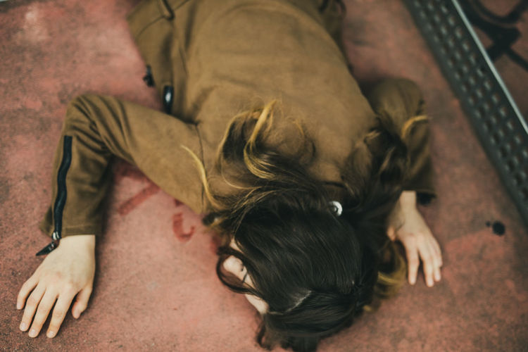 High angle view of woman lying on floor