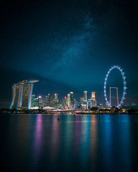 like diamonds in the sky. Nightphotography Singapore Cityscape City Skyline City Star - Space Cityscape Ferris Wheel Illuminated Galaxy Milky Way Sea Nightlife Light Trail Amusement Park Ride Space And Astronomy Long Exposure Light Painting Amusement Park Entertainment Carousel