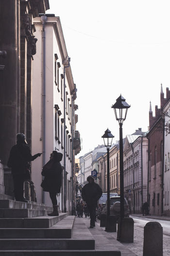 Cracow Architecture Building Exterior Built Structure Street City Real People Walking Men Lifestyles People Adult Women City Life Building Group Of People Street Light Sky Nature Leisure Activity Footpath Outdoors
