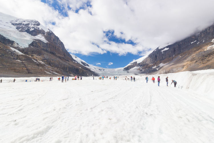 Athabasca August 2015 In this period of no snow, these tourists are visiting the Athabasca Glacier in Athabasca as it is one of the most accessibile and visited glaciers in North America. Alberta Alpine America Athabasca Athabasca Glacier Attraction Banff  Beautiful Blue Canada Canadian Canadian Rockies  Climate Cold Columbia Frozen Glacier Global Hiking Ice IceField Jasper Lake Landscape Melting Mountain Mountains National Nature North Outdoor Park Parkway Peaceful Peak Road Rock Rocky Scenery Scenic Sky Snow Summer Tourism Tourist Travel Warming Water White Winter