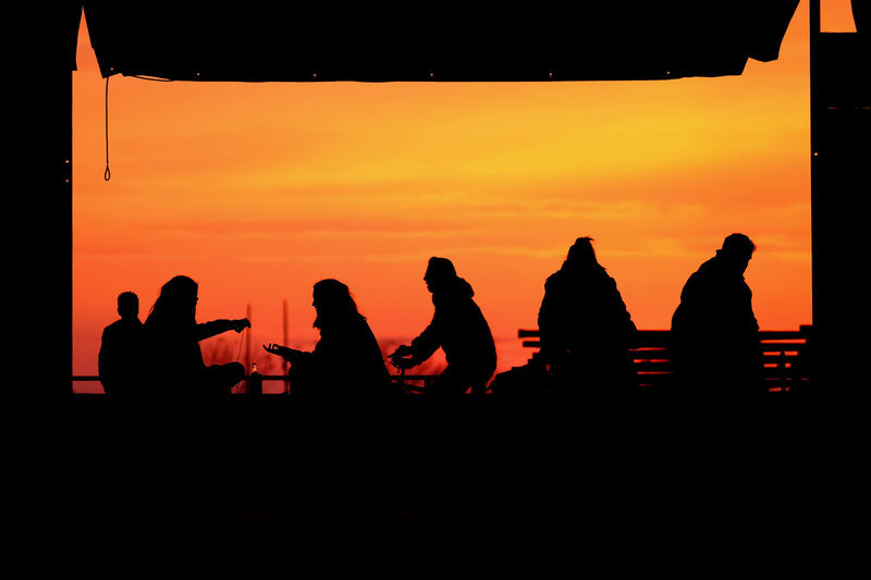 People enjoy the sunset in Düsseldorf. Adult Adults Only Indoors  People Red Sky Silhouette Sky Sound Recording Equipment Sunset Young Adult Sommergefühle Paint The Town Yellow Summer In The City