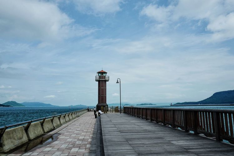 Cloud - Sky Day Nature One Person Outdoors People Pier Railing Sea Sky Water