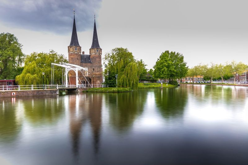 Eastern Gate at Delft Europe Delft , Netherland. Architecture Water Built Structure Building Exterior Sky Reflection Tree Travel Destinations My Best Photo