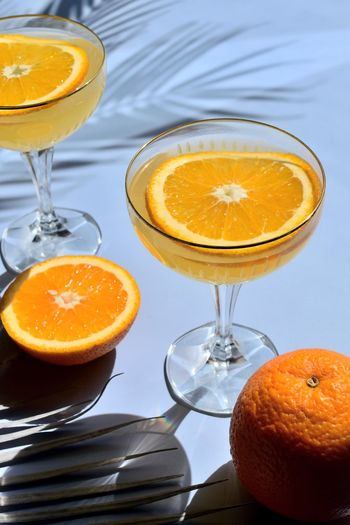Close-up of orange juice in glass on table