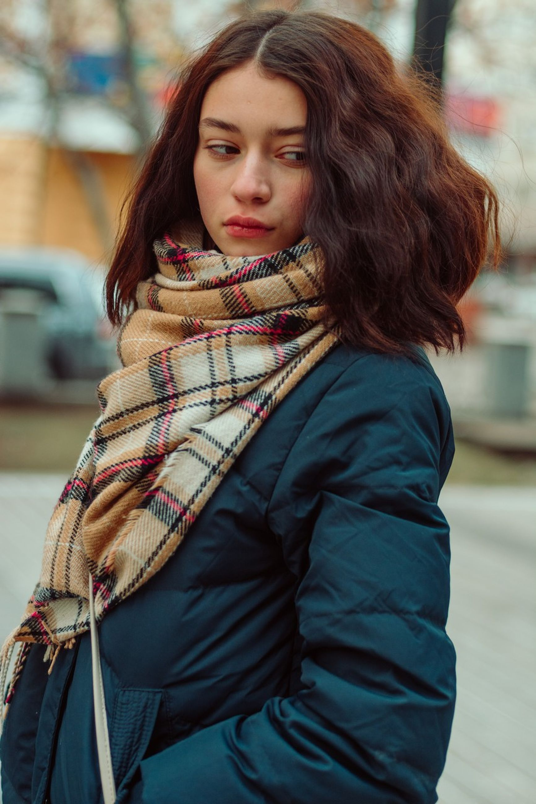 one person, young adult, focus on foreground, beautiful woman, young women, real people, long hair, hairstyle, women, beauty, clothing, lifestyles, hair, portrait, brown hair, adult, looking at camera, leisure activity, scarf, warm clothing, outdoors