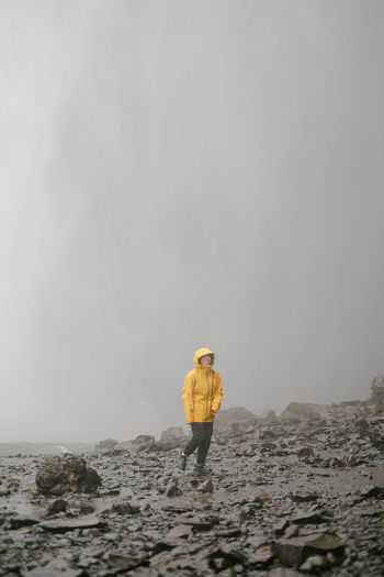Iceland Nature Rain Travel Yellow Jacket Red Jacket Skogafoss Waterfall