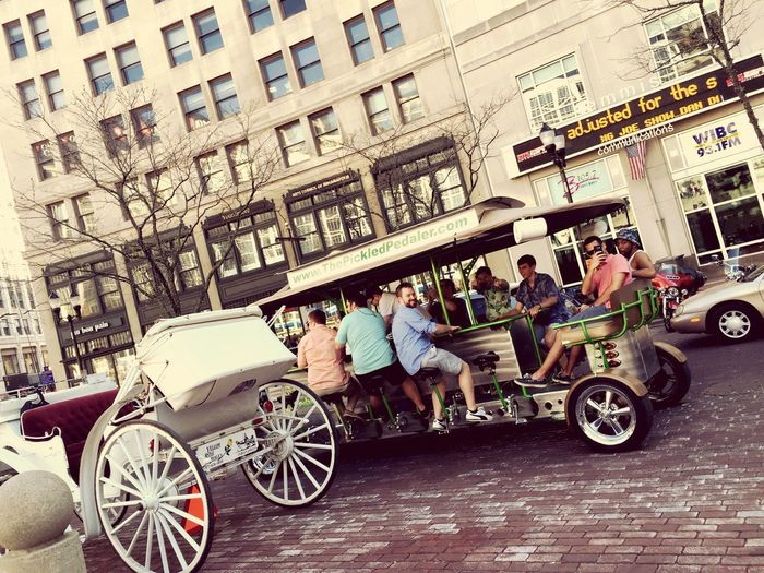 Transportation Building Exterior City Street Architecture City Life Mode Of Transport Land Vehicle Built Structure Outdoors Men Travel Travel Destinations Adult Bicycle People Horse Cart Road Sitting
