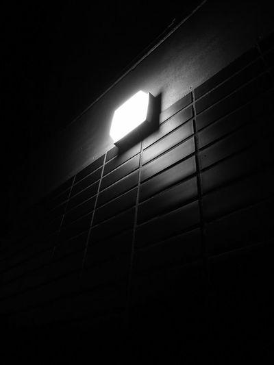 Low angle view of illuminated light at night