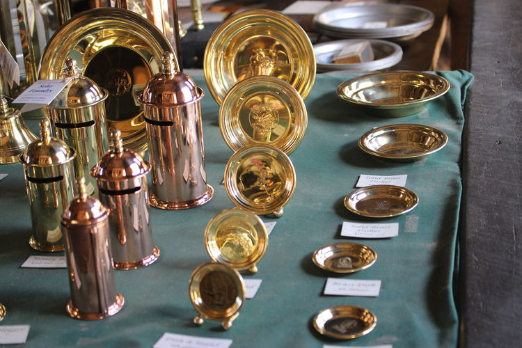 Copper and brass utensils for sale at market stall