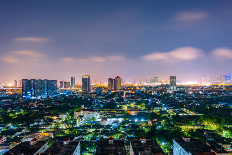 Cityscape from high rise building at night with skyline and clouds. skyscraper in metropolis town with beautiful neon light Bangkok Thailand. City Night Skyline Sky View Cityscape Bangkok Thailand Travel Light Downtown Modern Panorama Road Town Twilight Landscape Building Skyscraper Architecture Evening Tower Tourism Business Beautiful Urban Asian  Landmark Street Neon Metropolis Nighttime Clouds Dark Scenics Dusk Capital Design Top Backgrounds Structure Illuminated Trails Building Exterior Built Structure Urban Skyline Office Building Exterior Cloud - Sky Outdoors Tall - High Residential District