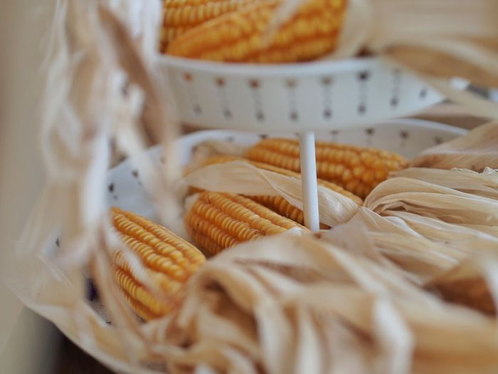 Close-up of corns in container