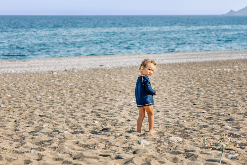Lonely toddler girl standing on beach - Cirali, Antalya Province, Turkey barefoot Beach Beach Photography Beach Life Life Is A Beach Blue Sky Carefree Caucasian Confidence  Copy Space Exploring Freedom Girl Girls Females Happiness Happy Independence Joy Lonely Looking At View Mediterranean  Mediterranean Sea Naked_art Nude-Art Pebble Pebble Beach Playing Portrait Preschooler Protection Sun Remote Location Semi-dress Semi-nude Side View Solitude Standing Summer Sunny UV Protection Swimwear T-shirt Toddler  Toddlerlife Vacations Watching Sandy Beach Playful Waiting Land Sea Childhood Child Sand Water Boys One Person Full Length Nature Blond Hair Horizon Over Water Horizon Males  Offspring Leisure Activity Men Day Hair Innocence Outdoors