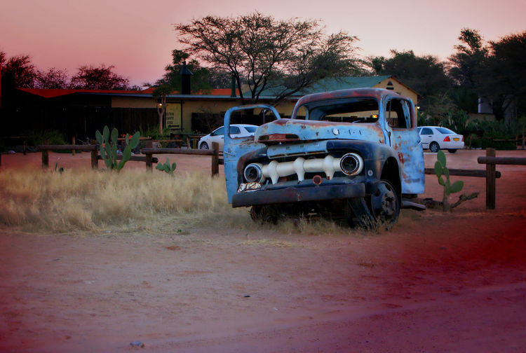 Time 's a' changing Old Truck Blue Magenta New Car Wreckage