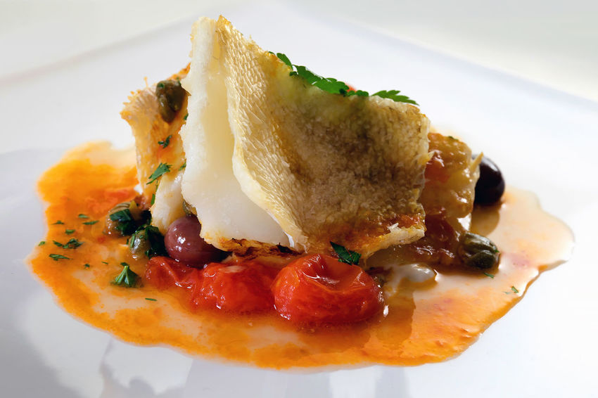 Slice of cod cooked and grilled in a pan with a sauce of cherry tomatoes, olives and capers, a pinch of parsley, oil and salt. Lunch COD Cooked Food Cuisine Dinner Italian Cuisine Ready To Eat SLICE Appetizing Food Capers Cherry Tomatoes Codfish Fish Fish Cuisine Gourmet Food Healthy Eating Nutritious Food Olives Omega Three Plated Food Preparation  Sauce Tasty
