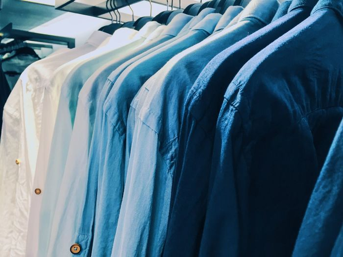 Close-up of shirt hanging for sale at store