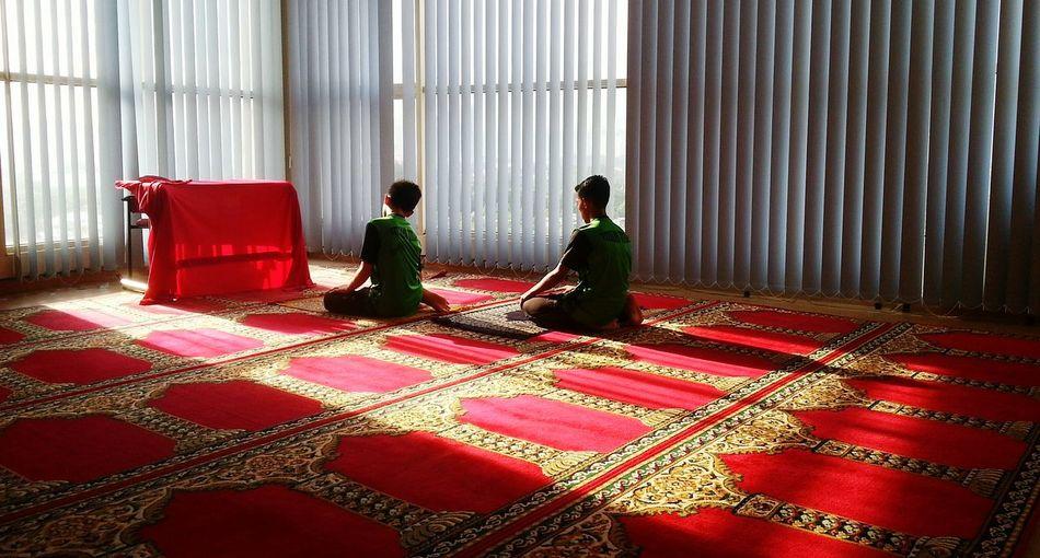 Men sitting in corridor