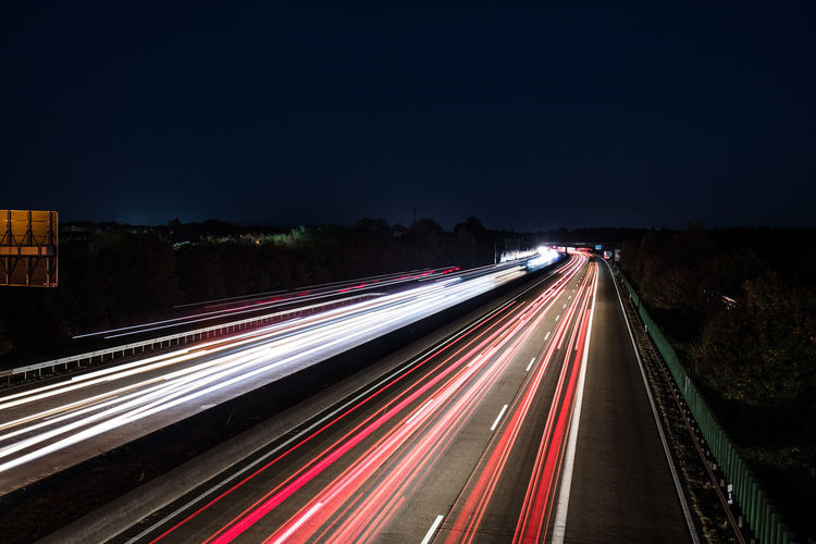 Long Exposure Motion Light Trail Speed Illuminated Night Road Transportation Blurred Motion City Street Traffic Sky Highway Nature No People Architecture City Life High Angle View Glowing Outdoors Vehicle Light Multiple Lane Highway