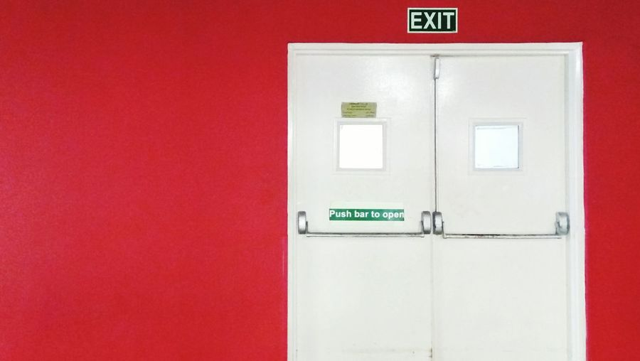 Text Exit Sign Emergency Sign Safety Instructions Fire Alarm Security System Occupational Safety And Health Red Urgency No People Smartphonephotograhy Minimalism Phoneonly PhonePhotography EyeEmNewHere EyeEm Selects Minimalist Photography  Built Structure Building Exterior