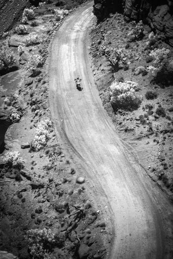 High angle view of dirt road amidst rocks