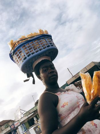 EyeEm Selects Real People One Person Leisure Activity Sky Cloud - Sky Lifestyles Low Angle View Food And Drink Day Outdoors Childhood Young Adult Food Building Exterior Architecture People Market Place Seller Basket On The Head