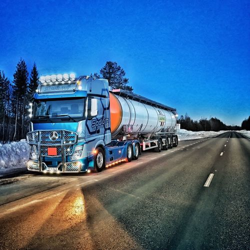 Transportation Blue Semi-truck Fuel Tanker Road Freight Train On The Road Mercedes Truck Mercedes-Benz HDR Collection Pictureoftheday Traveling Winter Hdr_Collection Hdr_lovers Beauty In Nature Actros Streetphotography Arctic Working Work Truckerslife