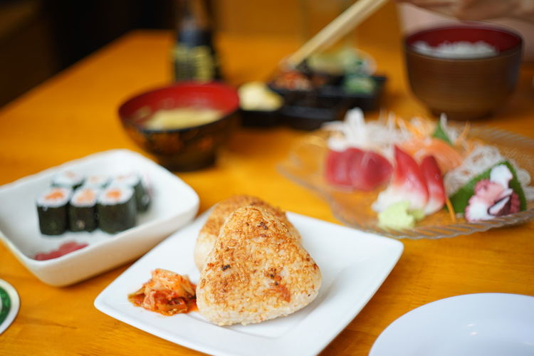 Onigiri Japan Japanese Food Onigiri Rice Sushi Bowl Bread Close-up Day Food Food And Drink Freshness Healthy Eating Indoors  No People Plate Ready-to-eat Restaurant Sashimi  Serving Size Still Life Table