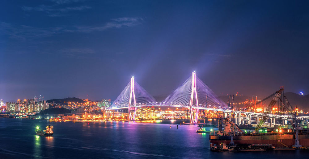 Busan Daegyo Bridge of Busan Port in South Korea City; Asia; Cityscape; Business; Travel; Architecture Bridge - Man Made Structure Building Exterior Built Structure Busan; Port; Korea; South City Cityscape Connection Illuminated Nautical Vessel Night No People Outdoors River Sea; Building; Urban; Asian; Landmark Sky Transportation Water Waterfront