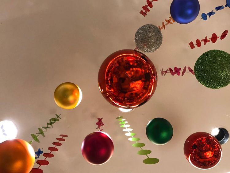 Celebration Looking Up Christmas Decoration Holidays Christmas Colors Hanging From The Ceiling Assorted Colors Christmas Balls It's Christmas! Festive Season Celebrating Point Of View Art Is Everywhere Neon Life Visual Creativity