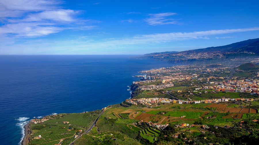 This panoramic photograph, taken at a Mirador in Los Realejos, shows the north coast of Tenerife and the Orotava Valley. Tenerife Teneriffa Los Realejos SPAIN Canary Islands Travel Travel Photography Landscape Coastline Coast Atlantic Ocean Panorama Panoramic View Mountain La Orotava Puerto De La Cruz Orotava Valley Sea Water Scenics - Nature Sky Horizon Over Water Beauty In Nature Horizon Building Exterior Architecture Blue Cloud - Sky Tranquil Scene Nature Built Structure Tranquility Day Idyllic Land No People Outdoors