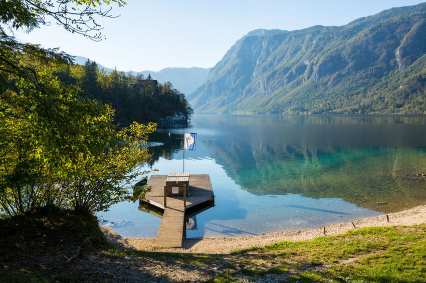 Nature Sky Day Bohinjsko Jezero Water Mountain Lake Beauty In Nature Scenics - Nature Reflection Tranquility Plant Mountain Range Non-urban Scene Tree Tranquil Scene Idyllic Sunlight No People Outdoors