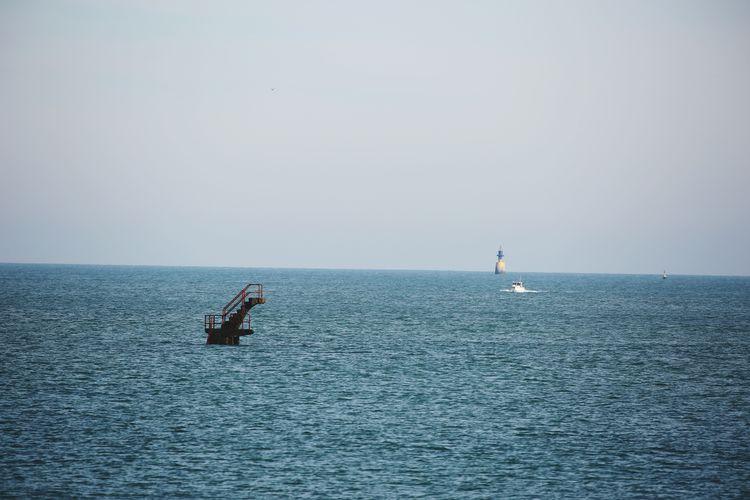 Lone Boat In Calm Blue Sea