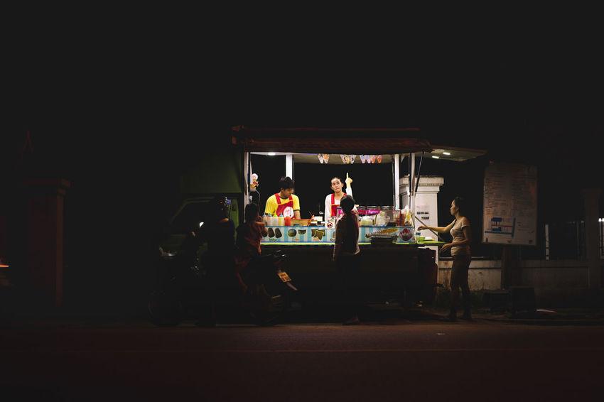 City Life City Nights Luang Prabang, Laos City Night City Night Lights Food Hawker Food Stall Hawker Hawking Goods Laos Laos Night Market Laos Peopl Laos Street Laos Street Photo Laos Street Photography Laos Street Scene Luang Prabang Night Market Ordering Food Pointing Pointing And Ordering Street Photography Street Scene Street Seller