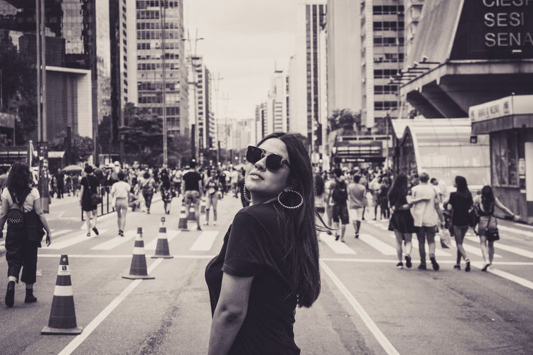 City Architecture Street Building Exterior Lifestyles One Person Built Structure Real People City Life Leisure Activity Standing Young Adult Day Sunglasses Incidental People Road Fashion Glasses Women City Street Outdoors Hairstyle Beautiful Woman