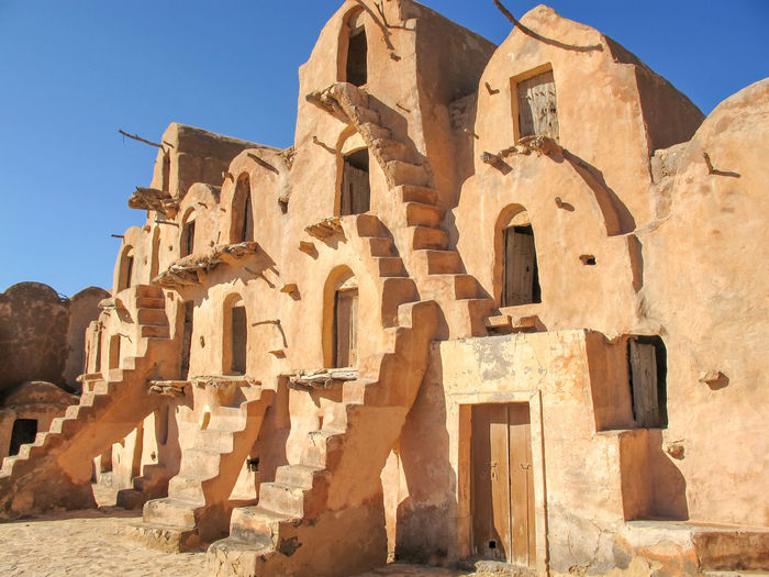 Tunisia Traditional houses, holidays Architecture Built Structure History The Past Building Exterior Sunlight Sky Nature Ancient Clear Sky Belief Building Religion Spirituality No People Travel Destinations Day Place Of Worship Tourism Travel Outdoors Ancient Civilization Archaeology