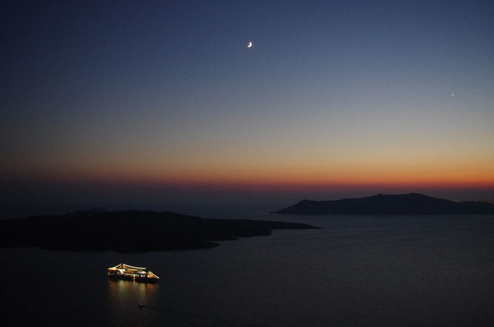 Griechenland Griechische Inseln Santorini Greece Santorini Island Santorini, Greece Astronomy Beauty In Nature Clear Sky Greece Moon Mountain Nature Nautical Vessel Night No People Outdoors Santorini Scenics Sea Sky Sunset Tranquil Scene Tranquility Transportation Water