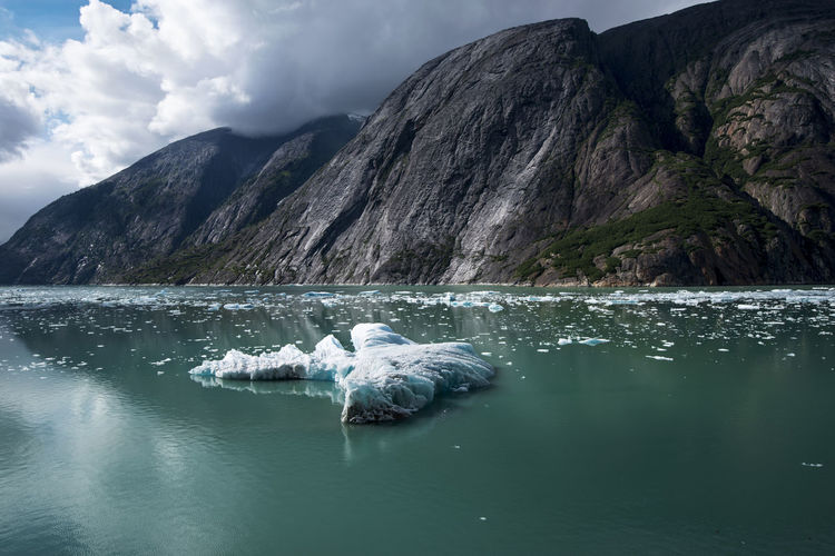 Scenic view of an iceberg and mountains in alaska