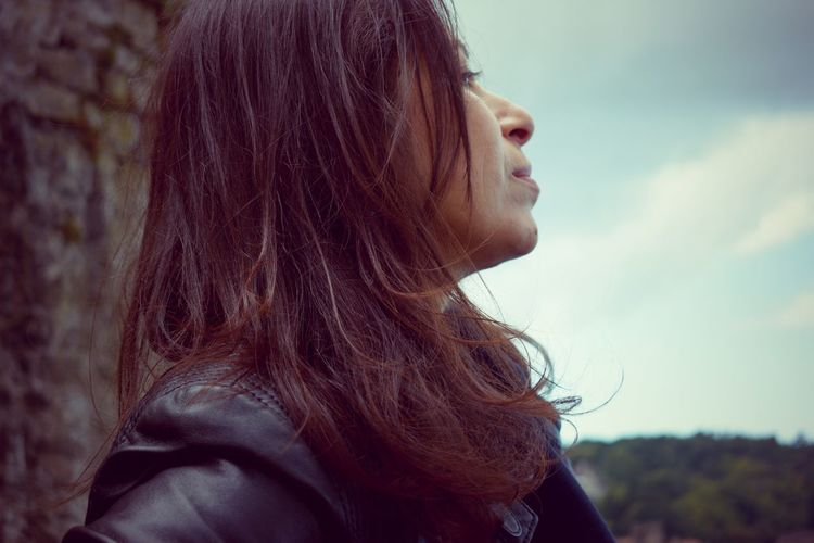 Side Profile Trees Woman Brown Hair Close-up Clouds Day Face Female Focus On Foreground Long Hair Nature One Person Outdoors People Person Real People Sky Stone Material