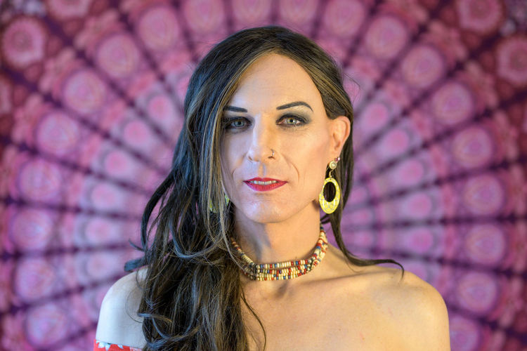 Close-up portrait of mature transgender looking away