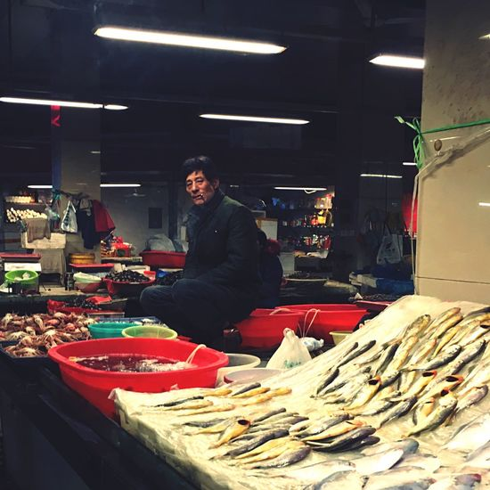 City Street Market Stall Indoors  One Man Only People Street China IPhone Streetphotography Market Life Salesman The Portraitist - 2017 EyeEm Awards