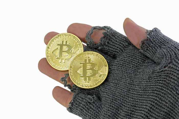 hand of poor man with two golden bitcoin ALMS Poor  Bankrupt Bankruptcy Bit Coin Bit Coins Bitcoin Bitcoin Coin Bitcoins Clarity Coin Concept Crack Currency Finance Financial Crisis Glove Homeless Human Body Part Money On White One Person Poorman Poverty Savings